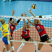 Vakifbank GS TT's Ozge Kırdar CEMBERCI (2ndL) and Gozde SONSIRMA (2ndR) Maja POLJAK (R) during their Women's Volleyball CEV Champions League semi final match at Burhan Felek Arena in Istanbul, Turkey on 20 March 2011. Photo by TURKPIX