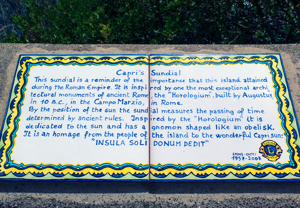 A tile plaque relating the history and description of the sundial located in the Gardens of Augustus