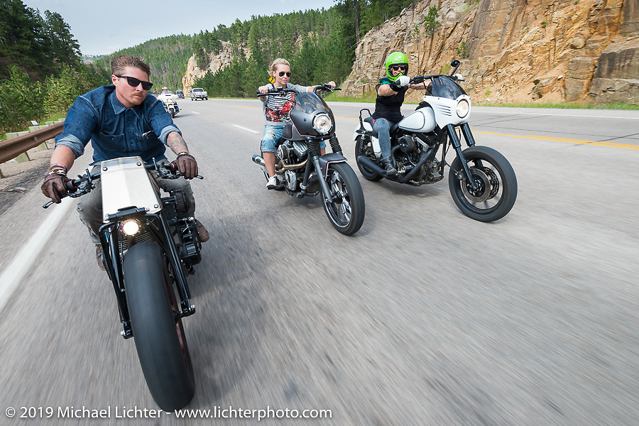(L-R) Roland Sands, Leticia Cline Michaels, and Jessi Combs on the Legends Ride from Deadwood, SD through Spearfish Canyon and to the Sturgis Buffalo Chip during the Sturgis Black Hills Motorcycle Rally. SD, USA. August 4, 2014.  Photography ©2014 Michael Lichter.