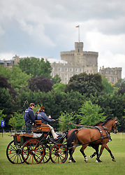 © under license to London News Pictures. LONDON, UK  11/05/2011. Riders put there horses through early morning exercise before entering the parade ring. The first day of The Royal Windsor Horse Show in the private grounds of Windsor Castle today (11 May 2011). Photo credit should read Stephen Simpson/LNP.