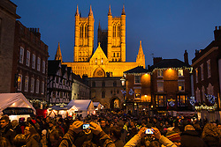 """© Licensed to London News Pictures. 7/12/2013. Lincoln, UK. Lincoln City Centre was packed with Christmas shoppers this weekend. Thousands of shoppers filled the City Centre and stewards were called in to direct people up the narrow """"Steep Hill"""" towards the upper area of Lincoln near the Cathedral. Photo credit : Dave Warren/LNP"""