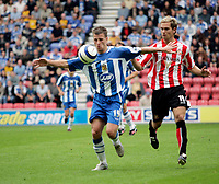 Photo: Peter Phillips.<br /> Wigan Athletic v Sunderland. The Barclays Premiership.<br /> 27/08/2005.<br /> Ryan Taylor (lefrt) controls the ball under pressure from Martin Woods