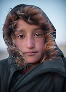 Young Shugni girl. In and around Bulunkul village and the Yashilkul lake. <br /> <br /> Driving on the Pamir Highway (M41) from Khorog through the Pamir mountains.<br /> <br /> Tajikistan, a mountainous landlocked country in Central Asia. Afghanistan borders it to the south, Uzbekistan to the west, Kyrgyzstan to the north, and People's Republic of China to the east. Tajikistan also lies adjacent to Pakistan separated by the narrow Wakhan Corridor.<br /> Tajikistan became a republic of the Soviet Union in the 20th century, known as the Tajik Soviet Socialist Republic.<br /> It was the first of the Central Asian republic to gain independence in December 1991.