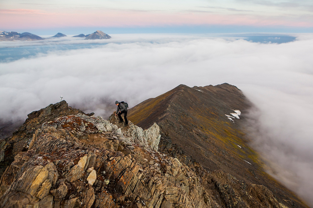 Rafal Flieger, taking time off from work at the Polish Polar Station, scrambles up the narrow ridge of Ariekammen for views over Hornsund, Svalbard.