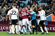 Aston Villa striker Jonathan Kodjia (26) in the thick of a melee with Swansea City defender Kyle Naughton (26) during the The FA Cup 3rd round match between Aston Villa and Swansea City at Villa Park, Birmingham, England on 5 January 2019.