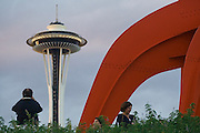 Tourists at the base of the Eagle sculpture (Alexander Calder, 1971) at the Seattle Art Museum Olympic Sculpture Park in Seattle, Washington. The Space Needle rises in the background.