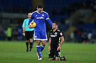 Sean Morrison, the Cardiff city captain checks on Sam Baldock of Brighton. EFL Skybet championship match, Cardiff city v Brighton & Hove Albion at the Cardiff city stadium in Cardiff, South Wales on Saturday 3rd December 2016.<br /> pic by Andrew Orchard, Andrew Orchard sports photography.
