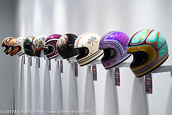 Display of handpainted Biltwell helmets by ten artists created for the Old Iron - Young Blood exhibition in the Motorcycles as Art gallery at the Buffalo Chip during the annual Sturgis Black Hills Motorcycle Rally. Sturgis, SD. USA. Tuesday August 8, 2017. Photography ©2017 Michael Lichter.