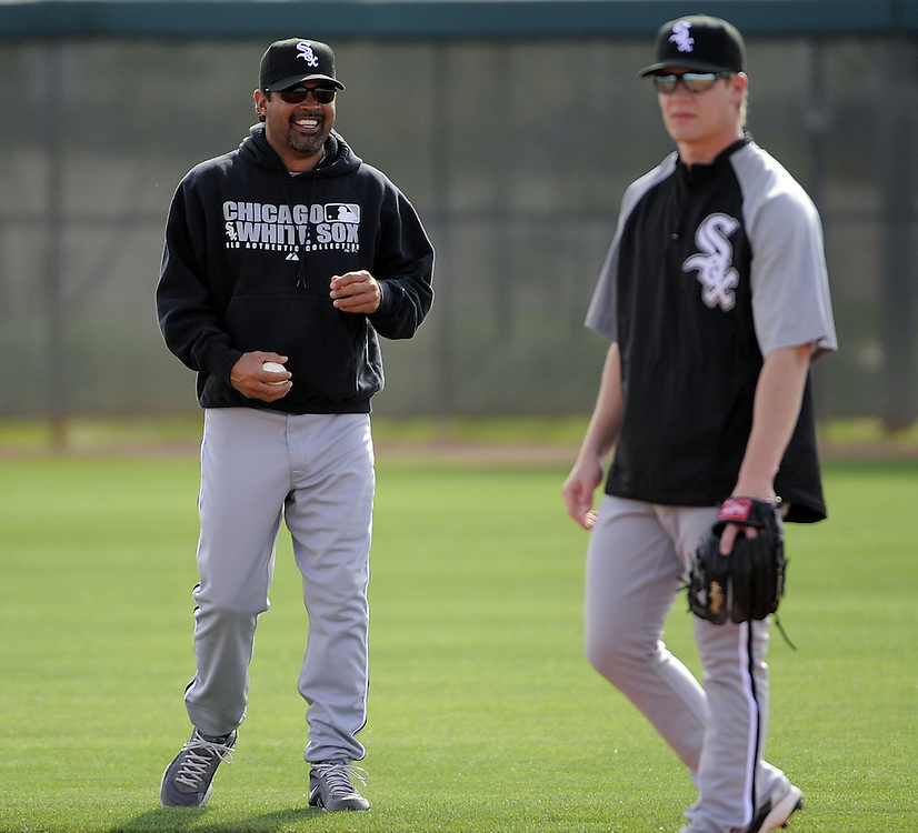 GLENDALE, AZ - FEBRUARY 24:  Manager Ozzie Guillen #13 jokes with Gordon Beckham #15 of the Chicago White Sox during a workout on February 24, 2010 at the White Sox training facility at Camelback Ranch in Glendale, Arizona. (Photo by Ron Vesely)