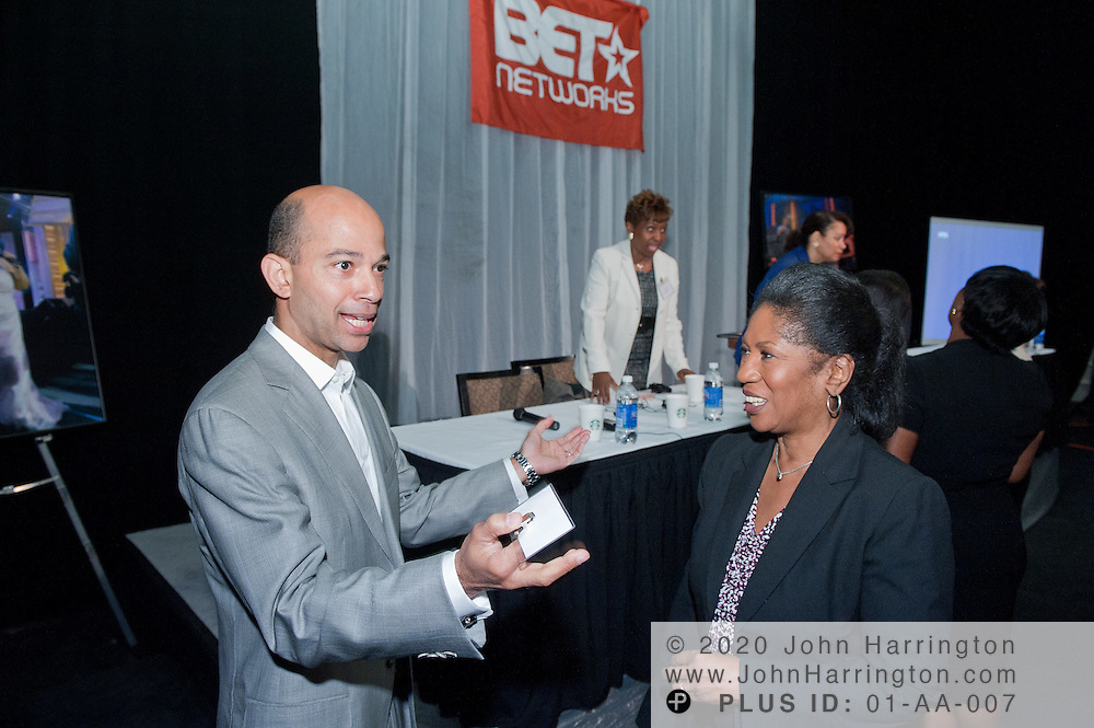 Scott Mills, President and COO of BET, greets Josephine Pamphile, President of the T. Howard Foundation after his presentation at the T. Howard intern orientation held at the BET Studios in Washington, DC on June 2nd, 2011.