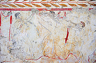Lucanian fresco tomb painting of a two men boxing whilst listening to the pipes of Eros. Pastrum 3rd Century BC .<br /> <br /> If you prefer to buy from our ALAMY PHOTO LIBRARY  Collection visit : https://www.alamy.com/portfolio/paul-williams-funkystock - Scroll down and type - Paestum Fresco - into LOWER search box. {TIP - Refine search by adding a background colour as well}.<br /> <br /> Visit our ANCIENT GREEKS PHOTO COLLECTIONS for more photos to download or buy as wall art prints https://funkystock.photoshelter.com/gallery-collection/Ancient-Greeks-Art-Artefacts-Antiquities-Historic-Sites/C00004CnMmq_Xllw