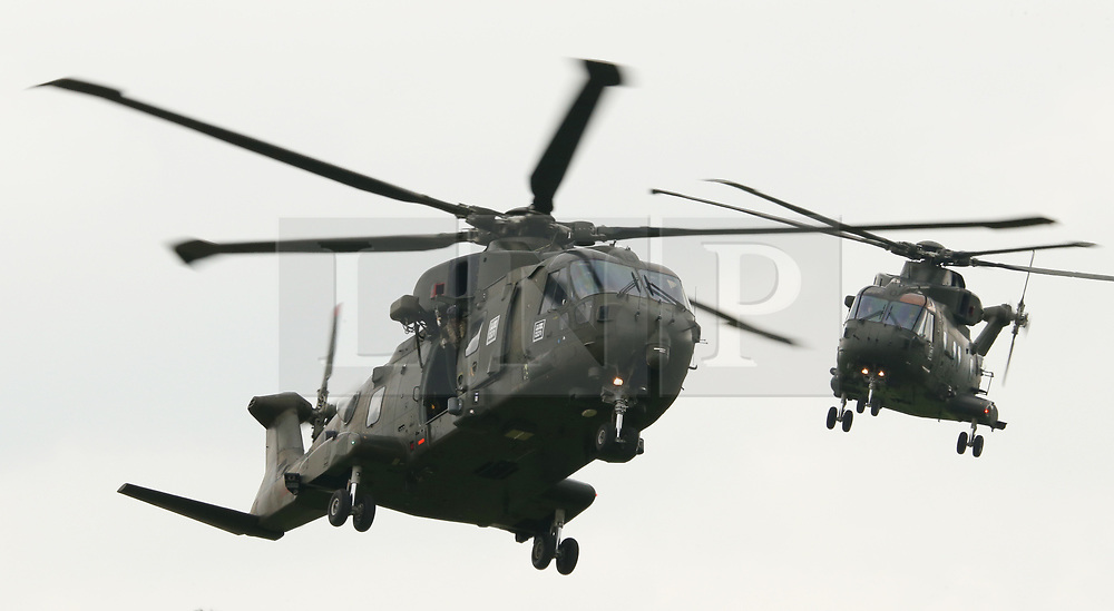 © Licensed to London News Pictures. 01/06/2018. RNAS Yeovilton, Somerset, UK. Royal Navy Merlin Helicopters of the Commando Helicopter Force perform a Role Demo in front of the families of pilots who have just recieved their wings .  Photo credit: JASON BRYANT /LNP