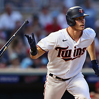 MINNEAPOLIS, MINNESOTA - JULY 23:Max Kepler #26 of the Minnesota Twins singles in the fifth inning against the Los Angeles Angels at Target Field on July 23, 2021 in Minneapolis, Minnesota. The Minnesota Twins defeated the Los Angeles Angels 5-4.  (Photo by Adam Bettcher/Getty Images) *** Local Caption *** Max Kepler
