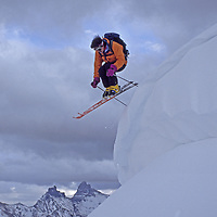 Beartooth Mountains, above Cooke City, Wyoming. A backcountry skier on Henderson Mountain, above Pilot & Index Peaks.