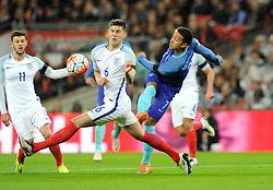 Memphis Depay of the Netherlands shoots under pressure from John Stones of England  - Mandatory by-line: Dougie Allward/JMP - 29/03/2016 - FOOTBALL - Wembley Stadium - London, United Kingdom - England v Netherlands - International Friendly