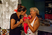 Darima with her daughter Jana and her new born grand daughter. Darina is working for her friend Maria who is the owner of a grocery store at Lunik IX. They are living in one of the buildings in a better condition then most of the others at Lunik IX, a decrepit housing complex almost entirely populated by Roma.