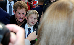 His Royal Highness Prince Harry poses for a photo with a member of the public - Photo mandatory by-line: Joe Meredith/JMP - Mobile: 07966 386802 - 9/09/14 - Winfield reception for the Invictus Games - London - Winfield House