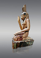 Ancient Egyptian wooden statue of osiris weeping, Late Period (664-332 BC). Egyptian Museum, Turin. Drovetti Cat 203.  Grey background. .<br /> <br /> If you prefer to buy from our ALAMY PHOTO LIBRARY  Collection visit : https://www.alamy.com/portfolio/paul-williams-funkystock/ancient-egyptian-art-artefacts.html  . Type -   Turin   - into the LOWER SEARCH WITHIN GALLERY box. Refine search by adding background colour, subject etc<br /> <br /> Visit our ANCIENT WORLD PHOTO COLLECTIONS for more photos to download or buy as wall art prints https://funkystock.photoshelter.com/gallery-collection/Ancient-World-Art-Antiquities-Historic-Sites-Pictures-Images-of/C00006u26yqSkDOM