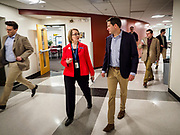 25 APRIL 2019 - DES MOINES, IOWA: Dr. JESSICA GOGERTY, Director of Central Academy, talks to US Representative SETH MOULTON (D-MA), as they walk through the halls of Central Academy. Rep. Moulton visited Central Campus High School in Des Moines Thursday to talk to high school students and the school's JROTC class about public service. Moulton, a US Marine veteran who served in Iraq, is running to be the Democratic candidate for the US Presidency in 2020. Iowa traditionally hosts the the first selection event of the presidential election cycle. The Iowa Caucuses will be on Feb. 3, 2020.             PHOTO BY JACK KURTZ