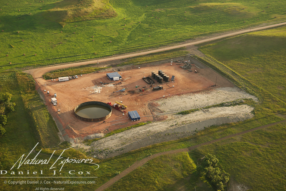 Oil development in the Bakken Formation among the bluffs of the Little Missouri River, North Dakota.