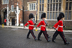 © London News Pictures. 22/10/2013 . London, UK.  Changing of the guard  outside the main entrance to St James's Palace in London ahead of the Christening of royal baby Prince George, which is due to take place at the Palace chapel tomorrow (Wed). Photo credit : Ben Cawthra/LNP