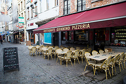 """© Licensed to London News Pictures. 23/11/2015. Brussels, Belgium. An empty restaurant at lunchtime on a deserted street in central Brussels where the city is currently on """"lockdown"""" amid """"imminent threat"""" of Paris-style bomb and gun attacks. Photo credit: Ben Cawthra/LNP"""