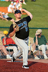 "1 June 2010: Thunderbolts starting pitcher Matt Jernstad warms up in the pen. The Windy City Thunderbolts are the opponents for the first home game in the history of the Normal Cornbelters in the new stadium coined the ""Corn Crib"" built on the campus of Heartland Community College in Normal Illinois."