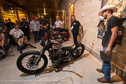 Custom builder Kyle Shorey in the In Motion invitational bike show build to other builders and judges during the Lone Star Rally. Galveston, TX. USA. Friday November 3, 2017. Photography ©2017 Michael Lichter.