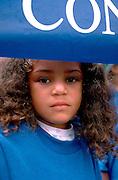 Girl age 8 holding banner for Rondo Days celebration.  St Paul  Minnesota USA