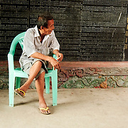 Man sitting inside Chinsese temple  at Yangon's downtown