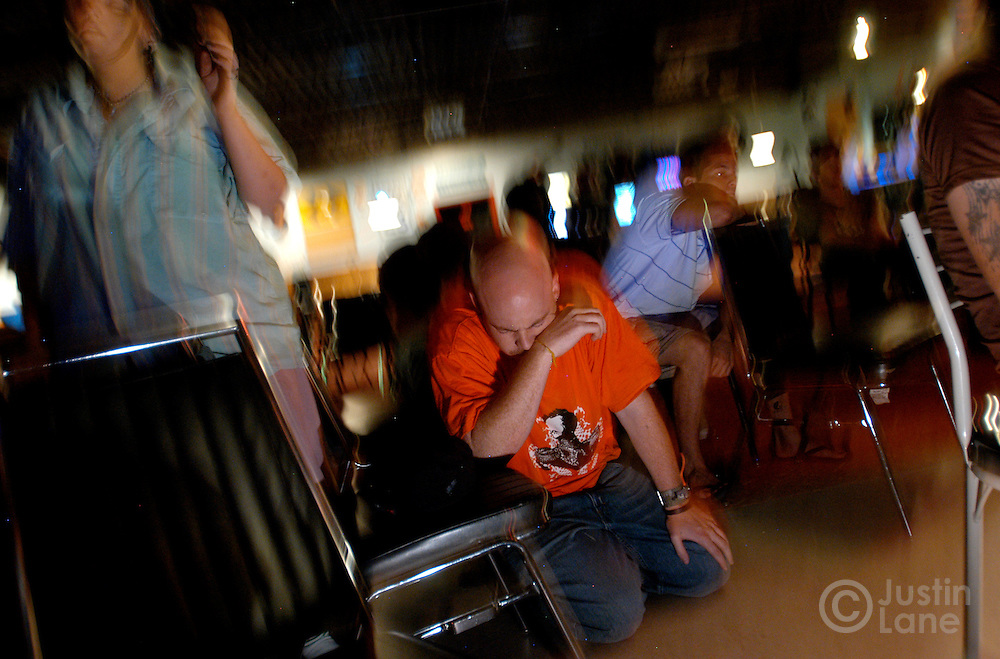 Jeremy Meeks, center, a Christian rap artist, bows his head in prayer following an event put on by The Extreme Tour, a travelling ministry of skateboarders and rock music, at a Christian club in Council Bluffs, IO, on Wednesday July 6, 2005. The tour is made up of volunteers who travel across the country evangelizing to at risk.