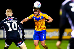 Alex MacDonald of Mansfield Town gets a head to the ball - Mandatory by-line: Ryan Crockett/JMP - 04/01/2020 - FOOTBALL - One Call Stadium - Mansfield, England - Mansfield Town v Grimsby Town - Sky Bet League Two