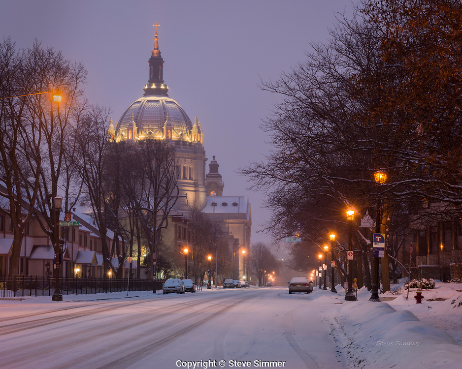 The St. Paul Cathedral with its lights on and dressed in light snow. A quiet, contemplative evening in the city.