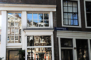 Amsterdam, The Netherlands. House and windows on the Prinsengracht - one of the channels in the centre of Amsterdam.