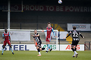 Scunthorpe United Alfie Beestin (22) heads the ball during the EFL Sky Bet League 2 match between Scunthorpe United and Grimsby Town FC at the Sands Venue Stadium, Scunthorpe, England on 23 January 2021.