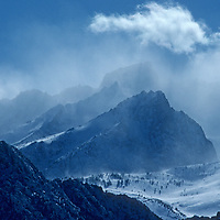 Wind blown snow engulfs 13,986-foot Mount Humphreys, above the Owens Valley in California's Sierra Nevada.