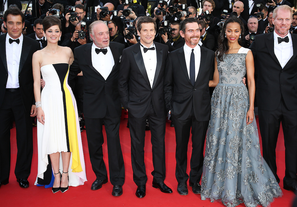 """(L-R) Clive Owen, Mariom Cotillard,James Cann,Billy Crudup, Guillaume Canet, Zoe Salanda & Noah Emmerich attend """"Blood Ties"""" Red Carpet  during the 66th Annual Cannes Film Festival at the Palais des Festivals on May 20, 2013 in Cannes, France.."""