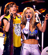 """Pop music star Britney Spears (R) and Steven Tyler (L) from the band """"Aerosmith"""" perform during the halftime show at Super Bowl XXXV in Tampa, Florida. January 28, 2001."""