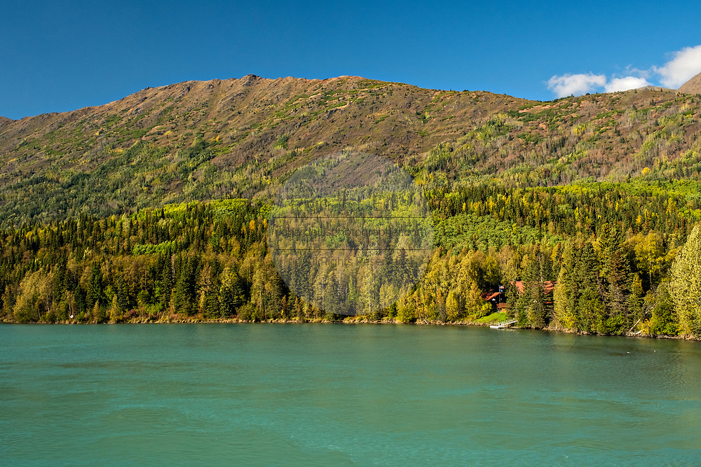The clear mountain waters of Kenai Lake and mountains at Chugach National Forest in Cooper Landing, Alaska. The temperate rain forest of the Chugach National Forest is the second-largest national forest in the United States.