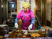 08 JUNE 2018 - SEOUL, SOUTH KOREA: A street food stall in Namdaemun Market. Namdaemun Market is one of the oldest continually running markets in South Korea, and one of the largest retail markets in Seoul.[6] The streets in which the market is located were built in a time when cars were not prevalent, so the market itself is not accessible by car. The main methods of transporting goods into and out of the market are by motorcycle and hand-drawn carts. It occupies many city blocks, which are blocked off from most car traffic due to the prevalence of parking congestion in the area.       PHOTO BY JACK KURTZ