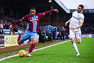Funso Ojo of Scunthorpe United (6) crosses the ball chased down by Conor Chaplin of Coventry City (10) during the EFL Sky Bet League 1 match between Scunthorpe United and Coventry City at Glanford Park, Scunthorpe, England on 5 January 2019.
