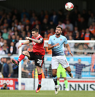 Morecambe's Jack Dunn and Blackpool's Clark Robertson<br /> <br /> Photographer Stephen White/CameraSport<br /> <br /> Football - The EFL Sky Bet League Two - Morecambe v Blackpool - Saturday 13th August 2016 - Globe arena - Morecambe<br /> <br /> World Copyright © 2016 CameraSport. All rights reserved. 43 Linden Ave. Countesthorpe. Leicester. England. LE8 5PG - Tel: +44 (0) 116 277 4147 - admin@camerasport.com - www.camerasport.com