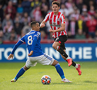 Leicester City's Youri Tielemans (left) battles with Brentford's Christian Norgaard (right) <br /> <br /> Photographer David Horton/CameraSport<br /> <br /> The Premier League - Brentford v Leicester City - Sunday 24th October 2021 - Brentford Community Stadium - Brentford<br /> <br /> World Copyright © 2021 CameraSport. All rights reserved. 43 Linden Ave. Countesthorpe. Leicester. England. LE8 5PG - Tel: +44 (0) 116 277 4147 - admin@camerasport.com - www.camerasport.com