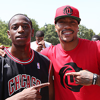 12 July 2013: Chicago Bulls superstar Derrick Rose poses with young french players on a playground near the Eiffel Tower during Adidas' D Rose tour,  in Paris, France.