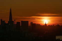 May 13, 2019 - London, London, UK - London, UK. The sun sets over the skyline of London after a warm day. Temperatures are set to rise up to 19 degrees Celsius with clear skies in the capital tomorrow. (Credit Image: © Tom Nicholson/London News Pictures via ZUMA Wire)