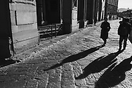 People walk past the Ufizzi Gallery next to the river Arno in Florence, Tuscany, Italy.<br /> Picture date: Sunday February 24, 2019.<br /> Photograph by Christopher Ison ©<br /> 07544044177<br /> chris@christopherison.com<br /> www.christopherison.com