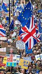 """© Licensed to London News Pictures. 23/03/2019. London, UK. Hundreds of thousands of people march through central London to demand that government allow a """"People's Vote"""" on the Brexit deal. Several key votes will be held in Parliament in the coming week. Photo credit: Rob Pinney/LNP"""