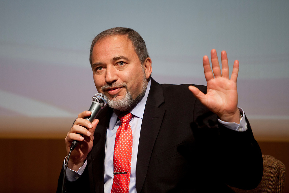 """Israel's Foreign Minister Avigdor Lieberman gestures as he speaks during a seminar titled: """"Changes in the status of the Knesset"""" at the Israeli parliament, on February 21, 2012."""