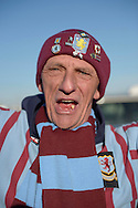an Aston Villa fan cheering outside Villa Park before k/o. The FA cup, 6th round match, Aston Villa v West Bromwich Albion at Villa Park in Birmingham, Midlands on Saturday 7th March 2015<br /> pic by John Patrick Fletcher, Andrew Orchard sports photography.