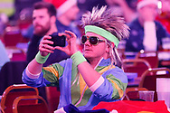 Darts fan taking a selfie during the PDC World Championship darts at Alexandra Palace, London, United Kingdom on 14 December 2018.